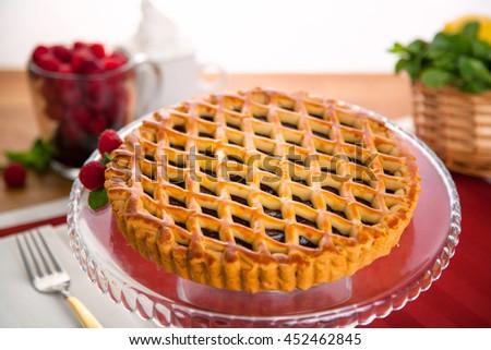 Whole homemade fresh raspberry mixed berry pie tart golden crust fruit filled delicious dessert - stock photo