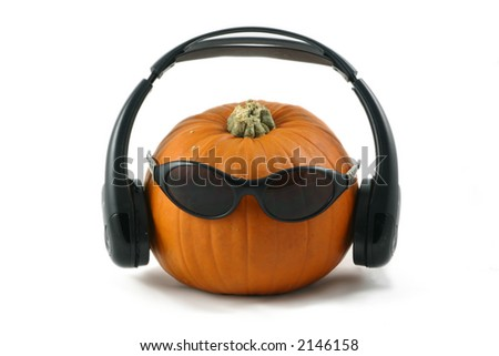 whole large pumpkin dressed as a dj with his headphones and dark glasses - stock photo