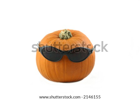 whole large pumpkin dressed  with his  dark glasses - stock photo