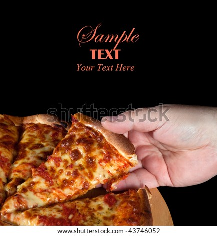 Whole Margharita Pizza over black background