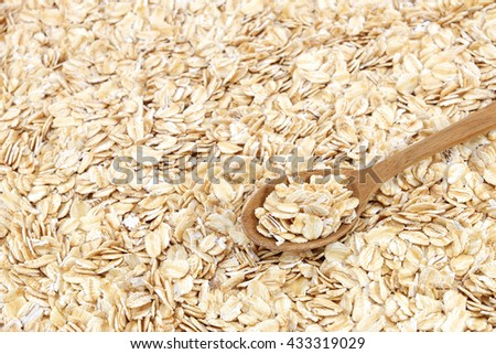 Whole muesli oat with wooden spoon (Spoon focus) - stock photo