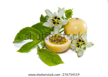 Whole passion fruit with slice, passionflower and leaf isolated on white background - stock photo