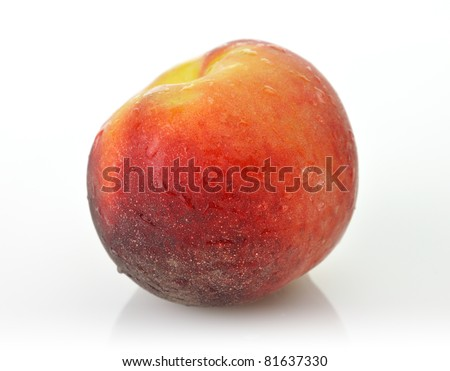 whole peach on white background with waterdrops - stock photo