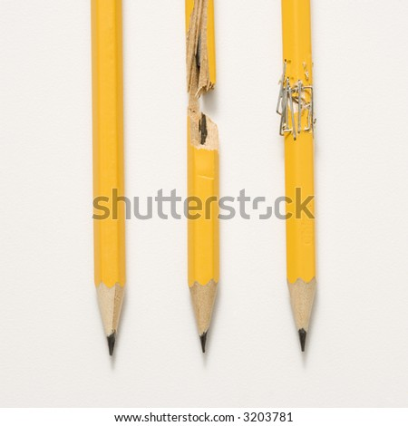 Whole pencil, broken pencil and stapled together pencil lined up against white background. - stock photo