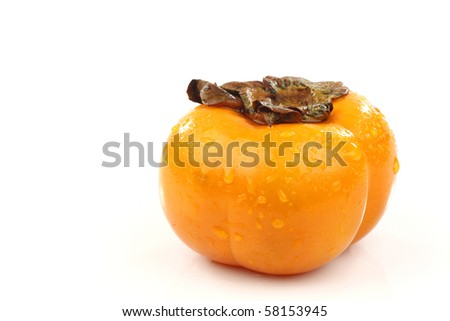 whole persimmon fruit on a white background