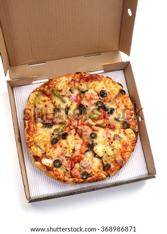 Whole pizza in a box  - stock photo