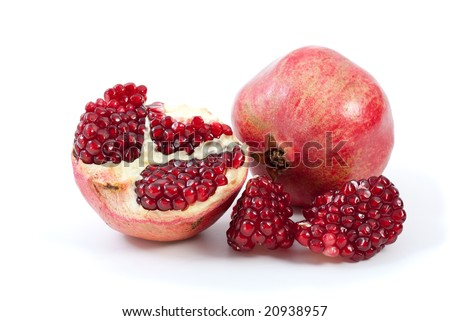 Whole pomegranate, half and pieces isolated on the white background
