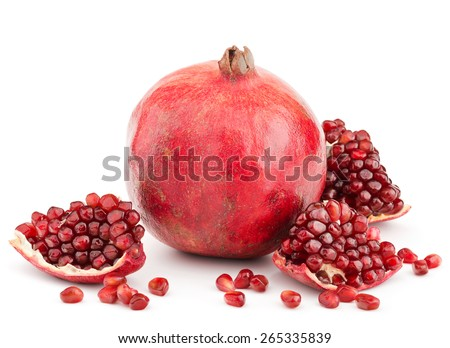 whole pomegranate with pieces and grains isolated on white background - stock photo