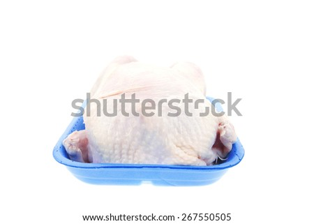 whole raw chicken on blue tray isolated on white background - stock photo