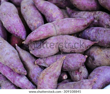 Whole red sweet potatoes - stock photo