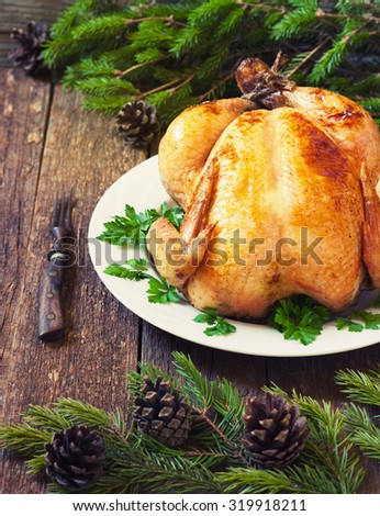whole roast chicken on New Year's wooden table toning - stock photo