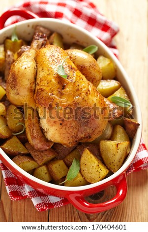 Whole Roasted Chicken with potatoes - stock photo