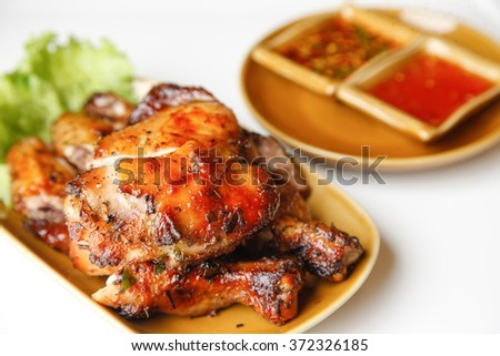whole roasted chicken with vegetables and sauce - stock photo