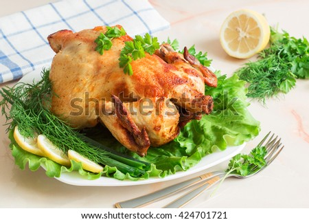 Whole roasted chicken with vegetables on plate - stock photo