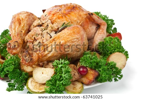 whole roasted stuffed chicken with parsley, vegetables and cranberries - stock photo