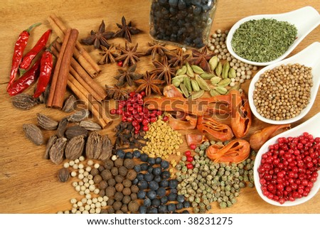 Whole variety of colorful spices. Assortment of cuisine ingredients - stock photo