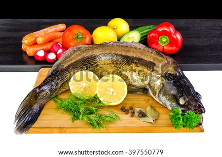 Whole walleye fish with vegetables - stock photo
