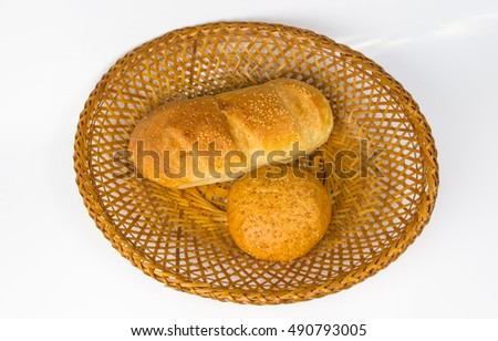 whole wheat bread and bun on a wicker plate