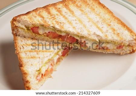 Whole wheat bread Bacon pesto and mozzarella panini - stock photo