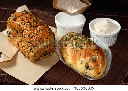 Whole wheat bread baked include sesame , pumpkin seeds , Sunflower Seed and  Almond. - stock photo