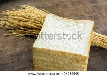Whole wheat bread cut on slices - stock photo