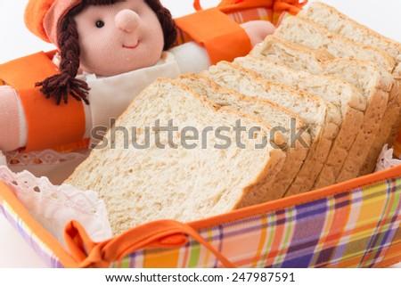 whole wheat  bread on basket - stock photo