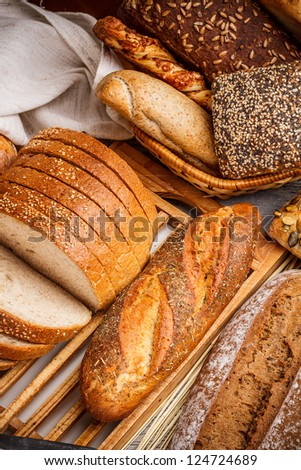 Whole wheat bread on cutting board - stock photo