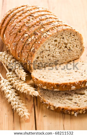 whole wheat bread on kitchen table - stock photo