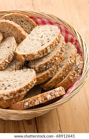 whole wheat bread on kitchen table - stock photo