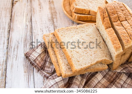 Whole wheat bread on white wooden background,meal or breakfast