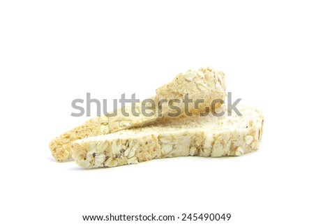 Whole wheat  bread with oat texture and sandwich raw on white background - stock photo