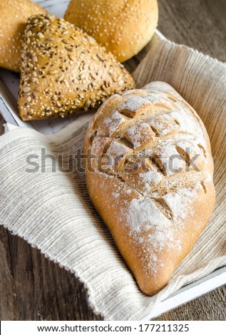 Whole wheat bread with sesame and flax-seed buns - stock photo