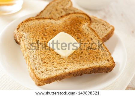 Whole Wheat Buttered Toast at Breakfast Time - stock photo