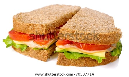 Whole wheat meat and cheese sandwich, isolated on white background