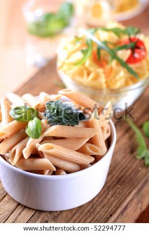 Whole wheat pasta tubes - stock photo