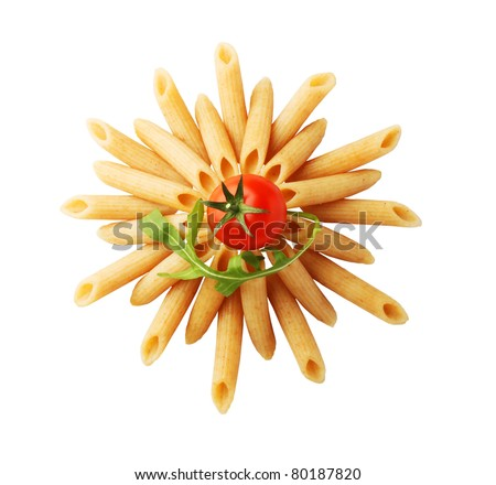 Whole wheat pasta tubes and red tomato - stock photo