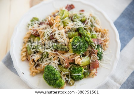 Whole wheat pasta with asparagus and broccoli - stock photo