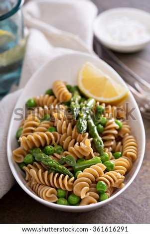 Whole wheat pasta with green peas and asparagus - stock photo