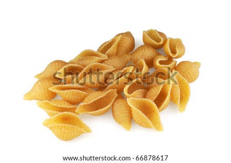Whole wheat shell pasta on white background