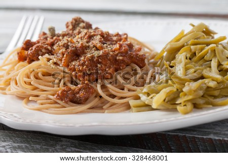 Whole wheat spaghetti with French style cut green beans close shot - stock photo