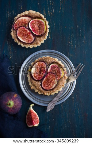 whole wheat tarts  with chocolate frangipane and figs, top view - stock photo