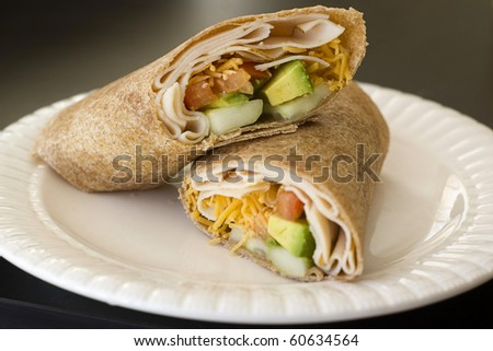 Whole Wheat Turkey and Avocado Sandwich Wrap - stock photo