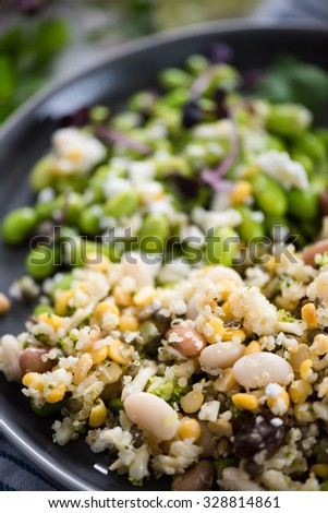 Wholefood vegetarian salad with edamame soybeans, quinoa and Kamut - stock photo