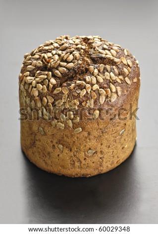 Wholegrain bread on black table - stock photo