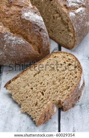 Wholegrain bread on wooden table - stock photo