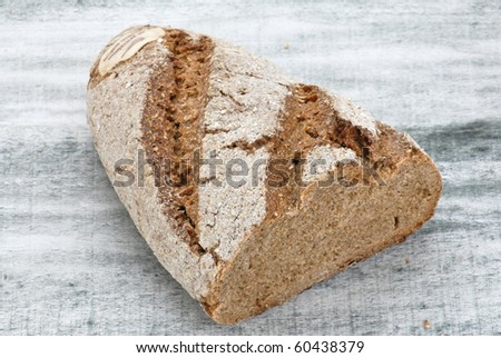 Wholegrain bread on wooden table, healty food - stock photo