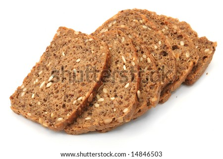 wholegrain bread with sunflower seeds on white background - stock photo