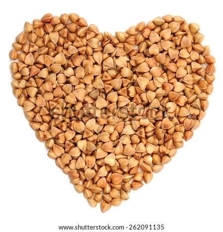 Wholegrain buckwheat in heart shape, isolated - stock photo