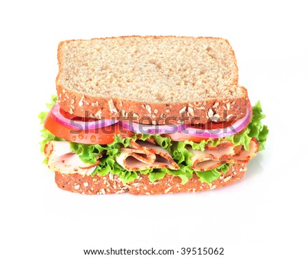 wholegrain turkey sandwich isolated on white - stock photo