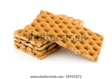 Wholemeal crackers isolated on white background - stock photo